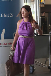 Marcia Gay Harden created a contrasting effect to her purple dress by wearing skinny belt on top of it.