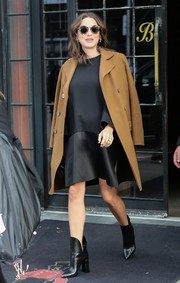 Marion Cotillard headed out in New York City looking edgy in a dual-textured black maternity dress.