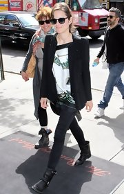Marion Cotillard's street style looked totally cool and chic with this black jacket paired with a loose blouse.