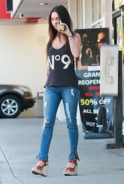 Megan Fox ran errands in a faded black graphic tank.