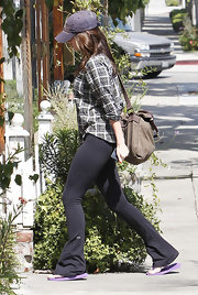 Megan Fox opted for a low-key look at the salon in tight black flared workout pants.