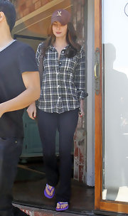 Megan Fox went incognito in a baseball cap and a green and navy plaid button down shirt.