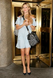 Meghan King Edmonds accessorized with a black-and-white dog carrier duffle (and an absolutely adorable puppy).