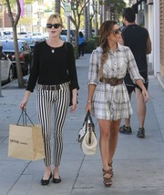 Melanie Griffith kept it comfy with a pair of black ballet flats while strolling with pal Eva Longoria.
