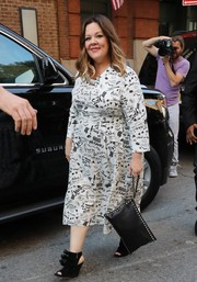 Melissa McCarthy looked playfully stylish in a black-and-white graffiti-print dress while out and about in New York City.