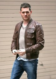 Michael Buble traded in his typical jazzy suit for a cool and casual bomber jacket.