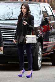 Michelle Trachtenberg wore a pair of ultra-high platform heels in bright purple suede while shooting a scene for 'Gossip Girl.'