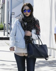 Reflective blue shades put a coo-girl spin on Michelle Trachtenberg's weekend outfit.