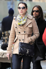 Michelle wears a patterned gray and yellow scarf while out shopping in NY.