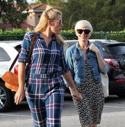 Busy Philipps teamed a camel-colored suede shoulder bag with a plaid jumpsuit for a day of shopping in Beverly Hills.