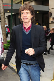A well-dressed Mick Jagger wore a fitted charcoal blazer over his thin knit and bright striped shirt as he exited The Carlyle Hotel in NYC.