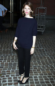 Sofia Coppola looked effortlessly chic in black suede ankle strap wedges.