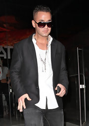 Mike wears a silver pendant necklace with a superman logo with his suit while out at Katsuya in LA.