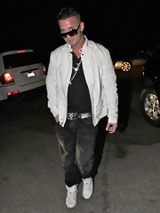 Mike wears faded black jeans with tennis shoes and white leather jacket while out in Hollywood.