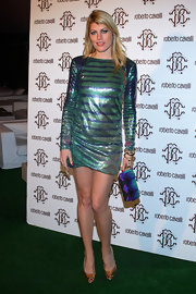Meredith Ostrom attended the Just Cavalli event wearing a colorful sequined dress. She added some additional flare with her bright printed clutch.