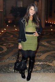 Margherita Missoni infused some edginess into her look with a pair of black knee-high boots.