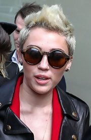 Miley Cyrus is not one to shy away from making fashion statements. The young star showed her style again with these round retro-inspired shades.