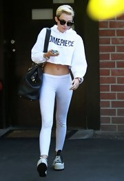 Miley's skinny pants balanced out her oversized cropped hoodie.
