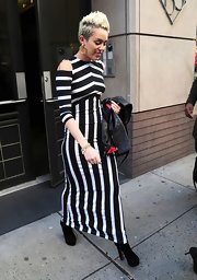 Miley worked the Beetlejuice trend in this black-and-white striped dress with funky shoulder cutouts.