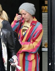 Miley Cyrus teamed a gray knit beanie with a colorful coat for a day of shopping.