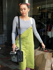 Miley Cyrus went for quirky styling with a Blippo Boombox bag.