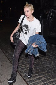 Miley Cyrus added a touch of glam with a pair of sparkly skinnies.
