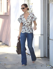 Minka Kelly was a '70s sophisticate in light flared jeans and a ruffled blouse.