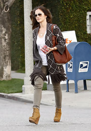 Minka wears a fringe hemmed open sweater while out running errands in Beverly Hills.
