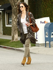 Minka Kelly looked casual yet chic in on-trend tan wedge lace up boots. She paired the ankle boots with skinny cargo pants and a tasseled sweater.