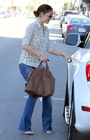 Minka Kelly added polish to her jeans with a luxe leather Nightingale bag.