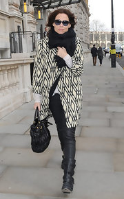Minnie Driver jazzed up her black street wear with a diamond print coat and black shades.
