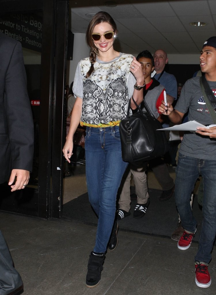 Miranda Kerr Arriving On A Flight At LAX
