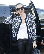 Miranda Kerr looked chic and cozy in this animal print cardigan for her venture to the airport.