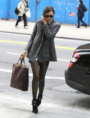 Miranda Kerr was chic while out and NYC in black suede ankle boots with buckled detailing.