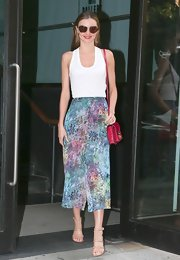 Miranda kept her printed maxi the center of attention with this basic white tank.