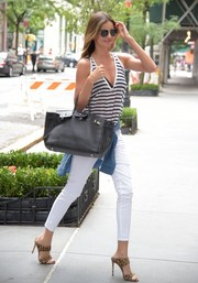 Miranda Kerr put a little cleavage on display in a low-cut black-and-white tank top while out and about in NYC.