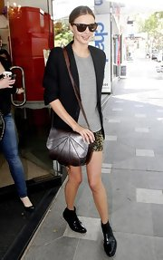Miranda Kerr did some shopping while toting a metallic shoulder bag.