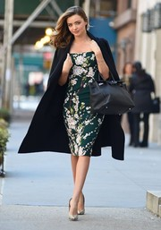 Miranda Kerr looked stunning in a floral green dress while walking around in NYC.