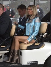 Fergie teamed her jacket with stylish gold mid-calf boots.