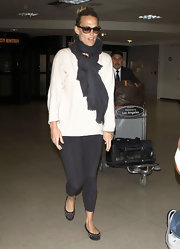 Molly was wrapped up in a gray scarf for her flight at LAX.