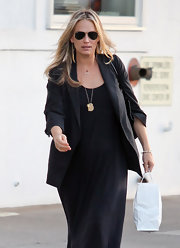 Molly Sims streamlined her expectant figure with a tailored black blazer and matching maxi dress.