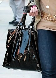 Morgan Fairchild was seen out and about in Beverly Hills showing off her black patent leather tote bag.