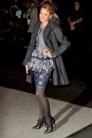 Blake Lively winterized her embellished ensemble with a classic gray shawl collar coat.
