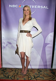 Yvonne's studded belt adds a nice touch of edge to the stars draped ivory dress.