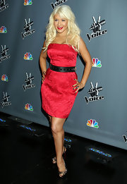 Christina Aguilera toughened her strapless red brocade dress with studded black slingbacks.