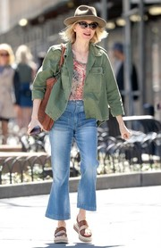 Naomi Watts toughened up a delicate print blouse with a green military jacket for a day out in New York City.