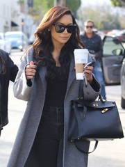 Naya Rivera geared up with a pair of rectangular shades and some coffee for a day out in West Hollywood.
