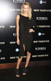 Natasha Poly opted for a more modern take on the LBD when she sported this single-sleeved frock.