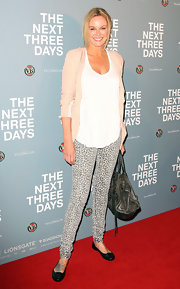 "Charlotte Dawson looked casual at ""The Next Three Days"" premiere in buckled black leather ballet flats."