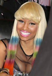Nicki completed her look with fluttering false eyelashes and a pop of pink lipstick.